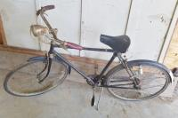 Vintage Robin Hood bicycle, 3 speed, hand brakes, light producer on back tire, tires flat.