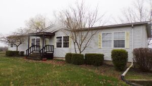 Tract 5- Guest house on 1 acre with basement and garage area.  This modular home is 3 bedrooms and