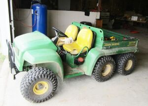 John Deere Gator, 2481 hours, diesel, dump bed. Click on the photo for additional pictures.
