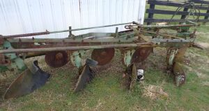 John Deere  145 4 bottom plow.  Click on the photo to see additional pictures.