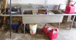 Commercial grade stainless steel 3 compartment sink. You must unhook and remove.
