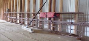Pipe hay elevator with electric motor, 15 feet 8 inches long.
