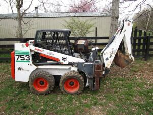 Bobcat 753 Skid Loader, Serial number 515832932, with only 149 hours with Backhoe Attachement, Serial number 584101428,  and also has the front bucket with it as well as the owner's manual. This is a like new machine. CLICK on the photo for additional pic
