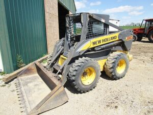 New Holland L190 skid loader,  Serial # NAM419754, 3,295 hours, fork attachment included,weights on one side only. Click the picture to see additional photos.