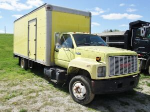 1992 GMC Topkick box truck, 20 foot box bed with rollup door and slide out ramp, 366 CID gas engine, shows 156,435 miles. Serial # 1G0J6H1P3NJ504181