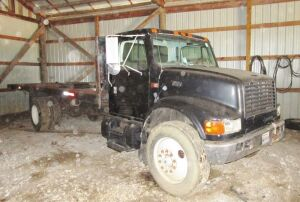1995 International 4900 DT 466 truck with 20 foot flatbed, 6 speed transmission, 364,399 miles. Serial # 1HTSDAAP25H692977