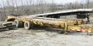 2007 Heavy duty Equipment Trailer 20 feet long, 5 foot dovetail, needs bed replaced, pindle hitch. Does have title.