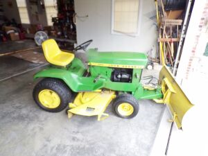 John Deere 140 lawn tractor with hydraulic snow blade on the front, rear wheel weights. Really slick!