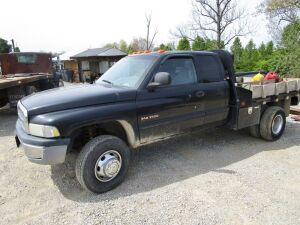 2001 Dodge 3500 dually truck with Norstar steel flat bed and mounted air compressor. 353,000 miles, 4WD, Cummins 24 diesel, standard transmission.