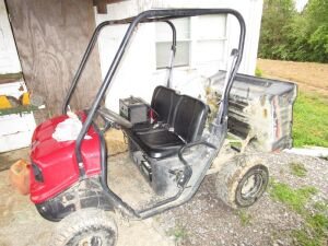 American Sportworks TW 200 Trail Wagon UTV with dump bed. Sprayer in back not included.