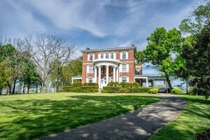 Historic Undulata Farm consisting of 92 acres of prime Kentucky land and all improvements including a three story brick home with over 9,200 square feet of living area and the remainder of equine facilities and other residential accomodations. These wouol