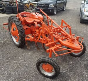 Allis Chalmers G cultivating tractor, the spider. In really good shape runs and drives. This is not part of the McDonald Estate and if you need additional information call Jimmy, 502.321.1111i.