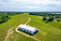 77 acres more or less of level to gently rolling Shelby County land off Mt. Eden Road. The farm is improved with a nice 40 x 110 foot metal barn with an attached 20 x 35 shed. There is also a frame home.  The farm is currently used as a cattle and hay far - 5