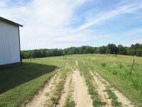 77 acres more or less of level to gently rolling Shelby County land off Mt. Eden Road. The farm is improved with a nice 40 x 110 foot metal barn with an attached 20 x 35 shed. There is also a frame home.  The farm is currently used as a cattle and hay far - 6