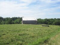 77 acres more or less of level to gently rolling Shelby County land off Mt. Eden Road. The farm is improved with a nice 40 x 110 foot metal barn with an attached 20 x 35 shed. There is also a frame home.  The farm is currently used as a cattle and hay far - 11