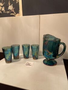 Blue carnival glass pitcher with 4 glasses, grape pattern