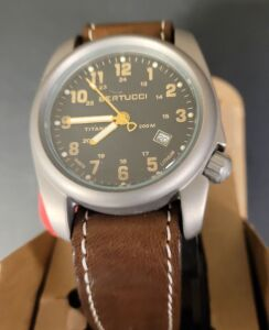 Bertucci classic field watch with brown leather band, titanium, second hand and date meter.