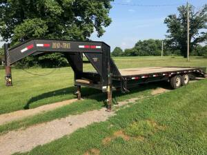 24 ft. Load-Trail flatbed gooseneck trailer. One owner in excellent condition with new tires all around and always stored inside. Has title.