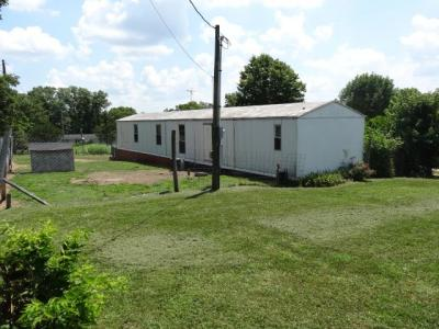 Real Estate:  3br 2ba manufactured home on nice lot, home is in great shape, well maintained.  The property has a large garage/shop building with electric great for work area.  The lot has some fencing and great location easy to get to city amenities.  Se